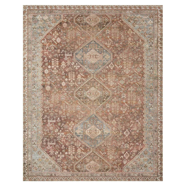 The Bayonne Spice / Sky Rug has a traditional diamond pattern in a dark red and blue colour palette.
