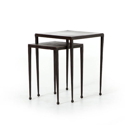 The Brechin Nesting Side Tables have tapered legs with rounded feet are made with aluminum with a rich rust finish.