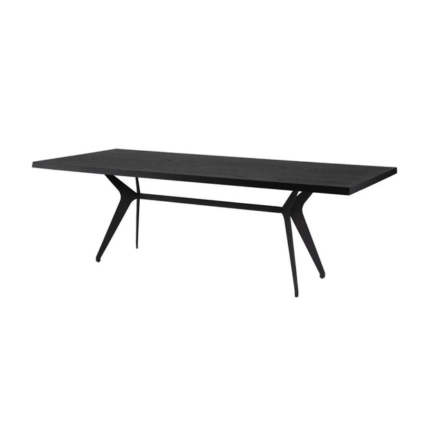 Contemporary dining room table with angled stainless steel legs and a black onyx tabletop.