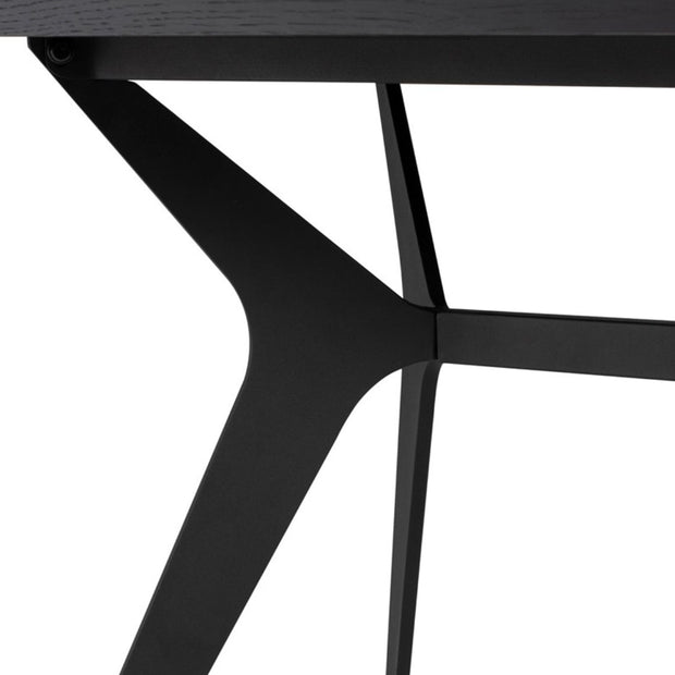 Angled leg details on the modern black dining table.