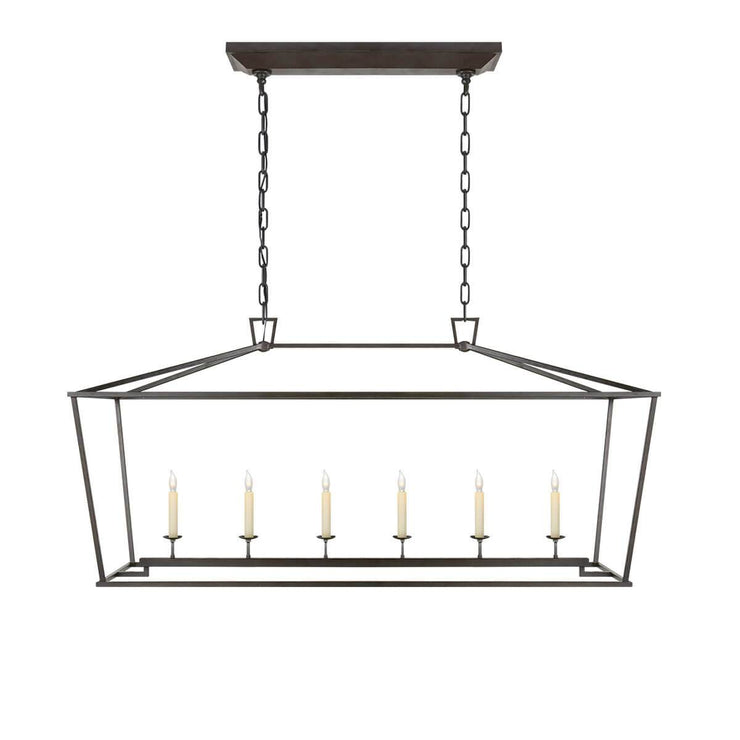 The Darlana Large Linear Lantern Lantern is an aged iron metal lantern frame with five candle-like lights.