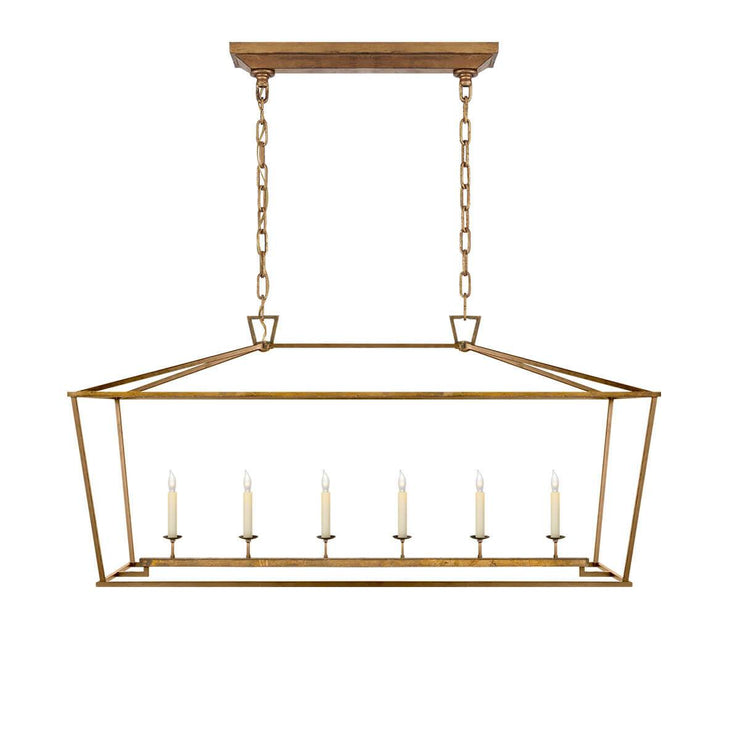 The Darlana Large Linear Lantern Lantern is a gilded iron metal lantern frame with five candle-like lights.