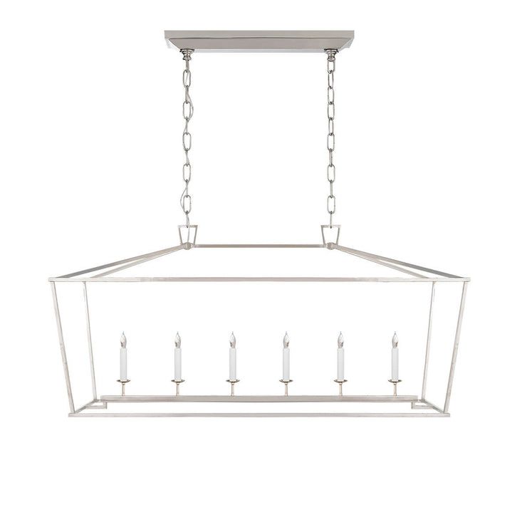 The Darlana Large Linear Lantern Lantern is a polished nickel, metal lantern frame with five candle-like lights.