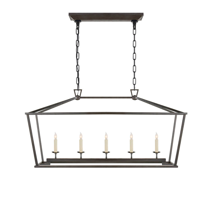 The Darlana Linear Lantern is an aged iron metal lantern frame with five candle-like lights.