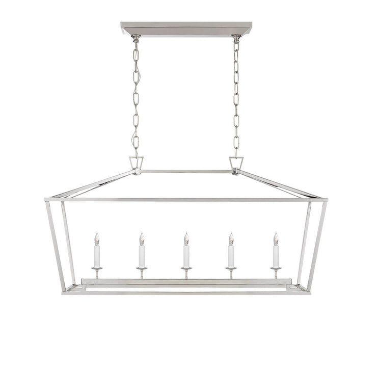 The Darlana Linear Lantern is a polished nickel metal lantern frame with five candle-like lights.