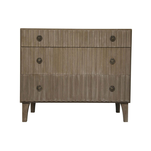 The Blackpool Dresser is a three drawer dresser made from weathered mahogany wood with ridged detail on the drawer fronts.