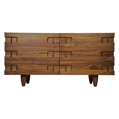 The Bern Sideboard is made from walnut with a rich finish and has carved notch details on the corners.