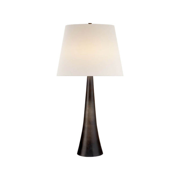 The Dover Table Lamp has a tall, cone-shaped base with an aged iron finish and a linen shade.
