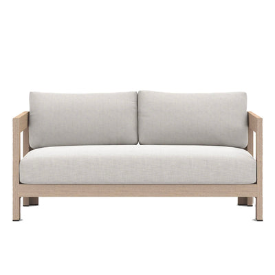 Outdoor sofa with light grey fabric and teak frame.