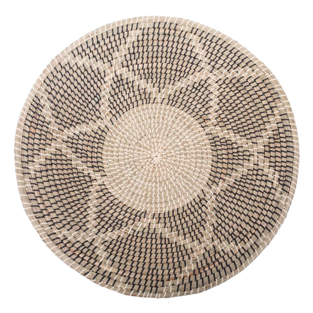 Wall basket art with a charcoal and natural seagrass pattern.