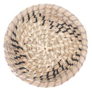 Woven seagrass wall basket with abstract light grey, charcoal and white pattern.