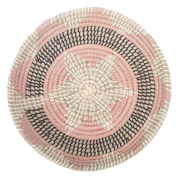 Seagrass basket with abstract geometric pattern.