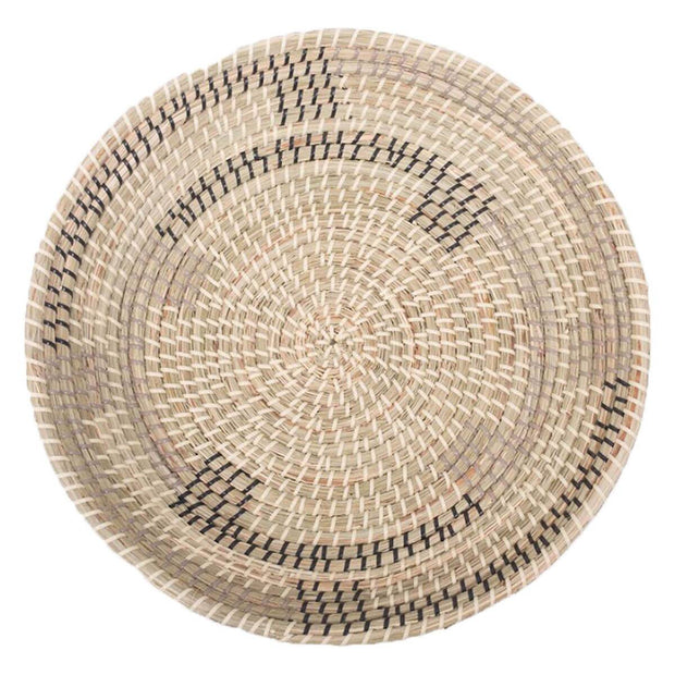 Abstract geometric woven seagrass decorative basket.