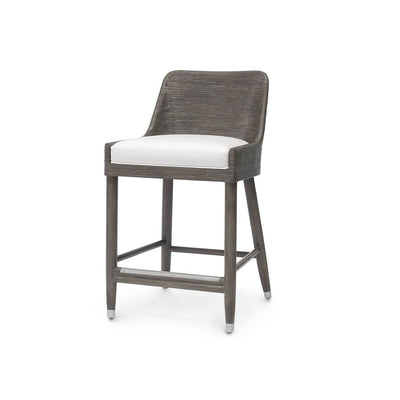 The Brookings Counter Stool has a hardwood frame, core rattan hand-wrapped seat back and arms, and a fixed upholstered seat.