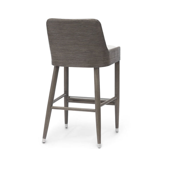 The organic, bar stool with hardwood legs, hand-wrapped core rattan seat back and arms, and an upholstered seat.