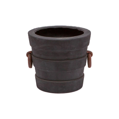 A stone pot perfect for decor inside or outdoors. Made of reconstituted stone and finished in black. This pot is available in two sizes, this image shows the small.