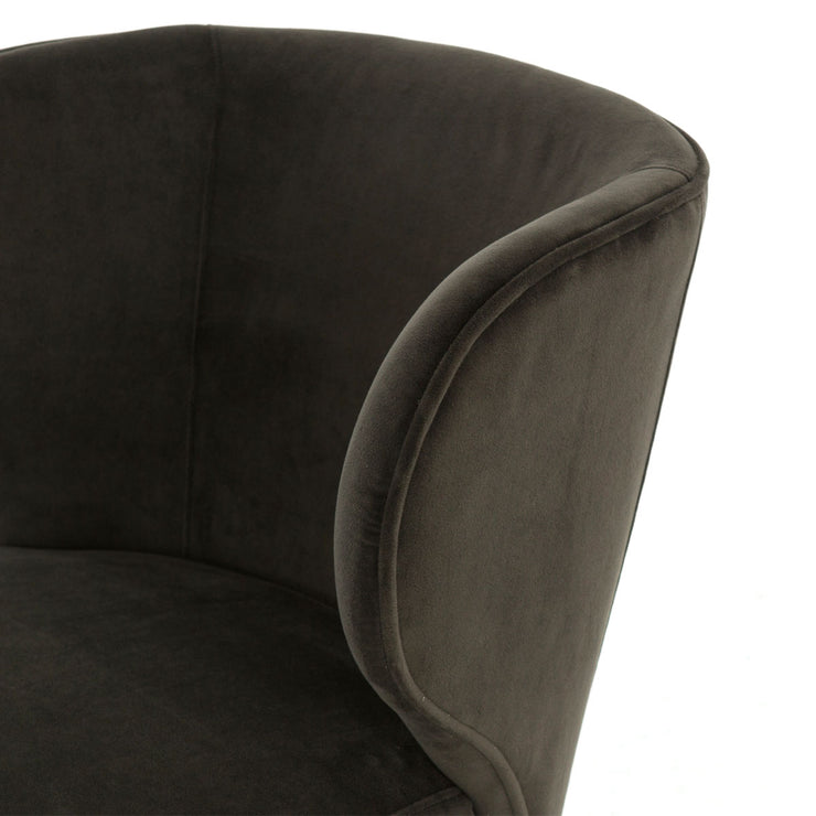 Suede dining chair with wing back shape.