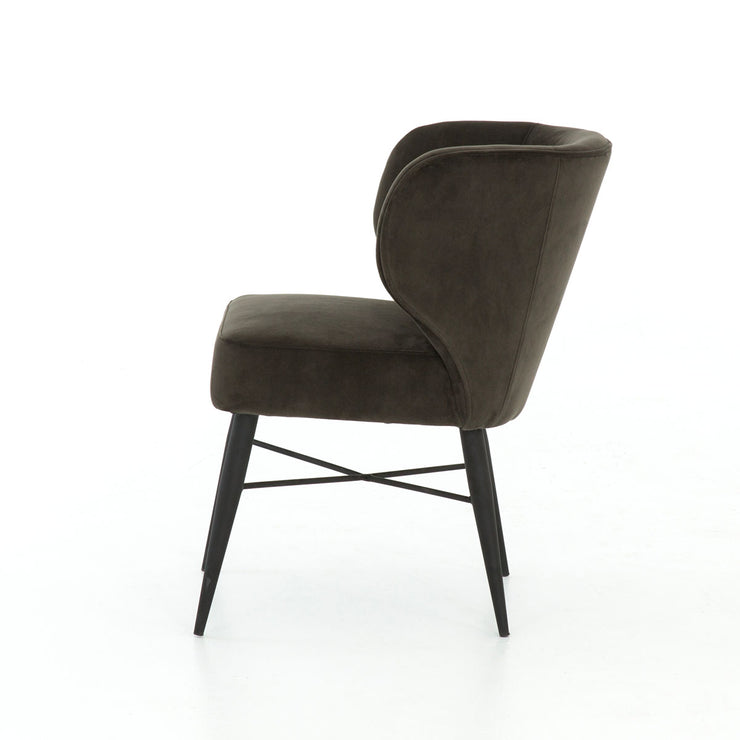 A unique, luxurious dining chair with a modern take on the wing back chair.