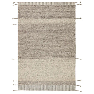 West Coast, minimalist-style, handwoven rug made of tonal grey wool, featuring braided tassel details.