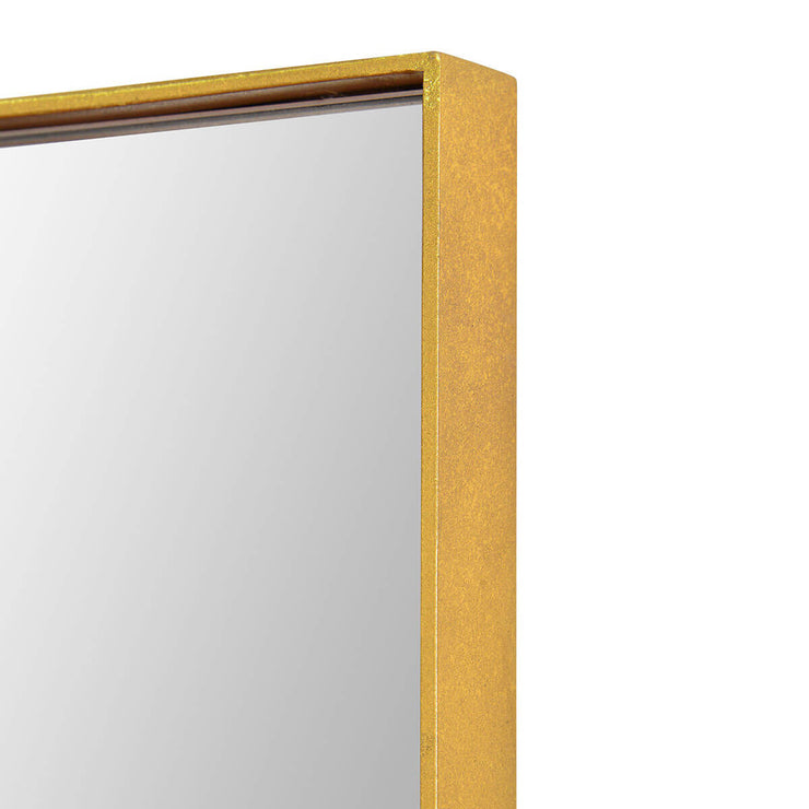 Thin gold frame on an oversized rectangular mirror.