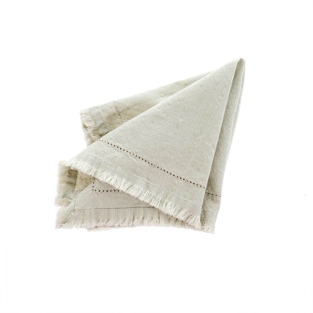 The Frayed Edge Napkin - Moonstruck is a soft grey, stone-washed napkin with a hemstitched border and frayed edge.
