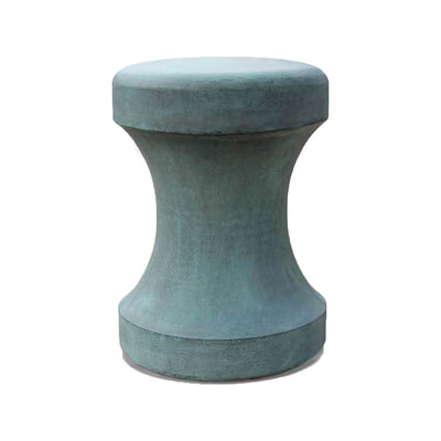 The Coyocoan Stool in a modern shape is made of reconstituted stone for durability.