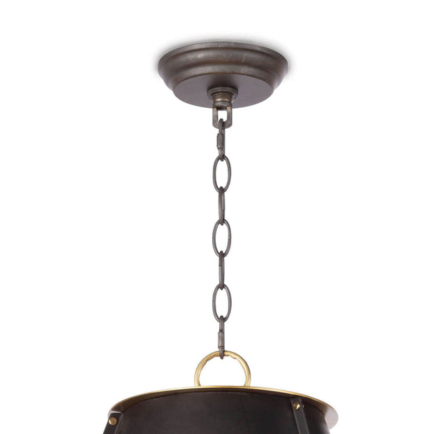 Closeup of the black canopy and chain on the metal, modern farmhouse pendant light.