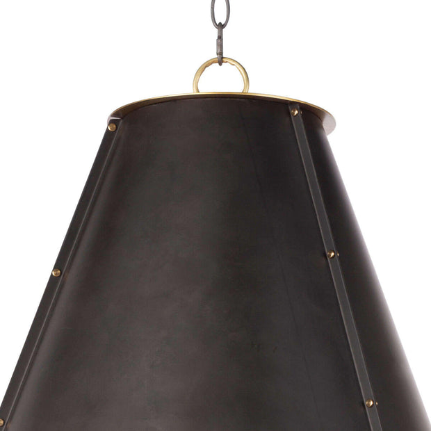 Closeup of the black metal cone shaped pendant light with stud details.
