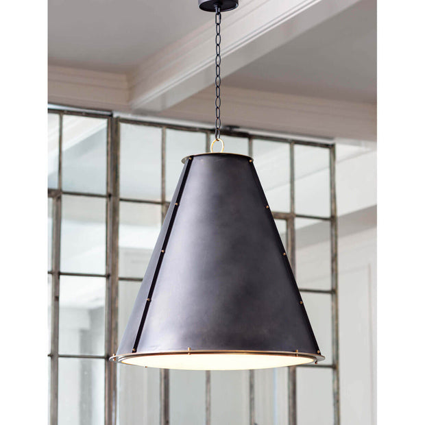 Black studded pendant light in a modern kitchen.
