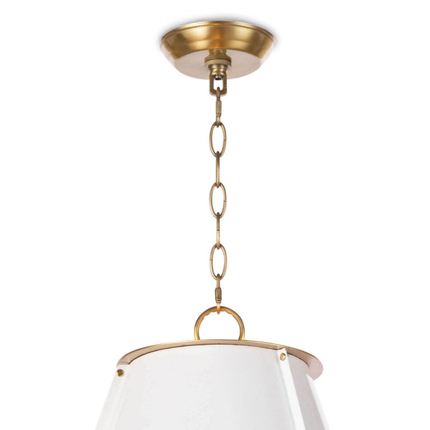 Closeup of the brass canopy and chain on the modern pendant light.