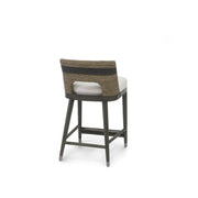 Bohemian counter stool with brown and black striped, lampakanai rope seat and white upholstered seat.