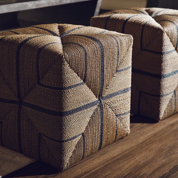 The cube shaped ottoman made from hand crafted rope in a grey with black stripe finish.