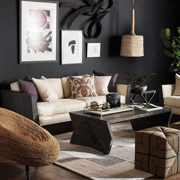 Modern cube shaped ottoman with lots of texture in a living room.