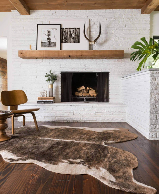 The Arizona Camel / Beige Rug in front of a living room fireplace.