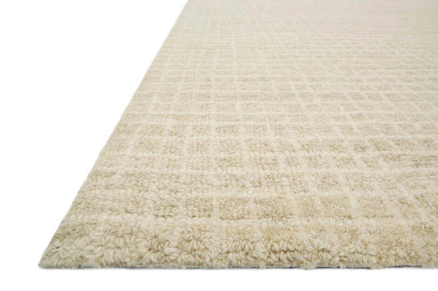 Details of the Atrani Antique Ivory Rug. Textured hand hooked wool rug.