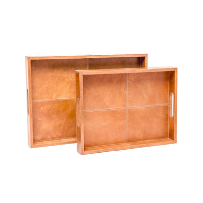 A beautiful, aged, pair of caramel leather decorative trays. Made of textural full grain leather.