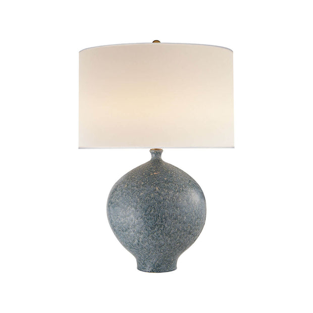 The Gaios Table Lamp has a rounded, textured blue lagoon body and a round linen shade.