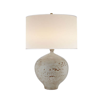 The Gaios Table Lamp has a rounded, textured pharaoh white body and a round linen shade.