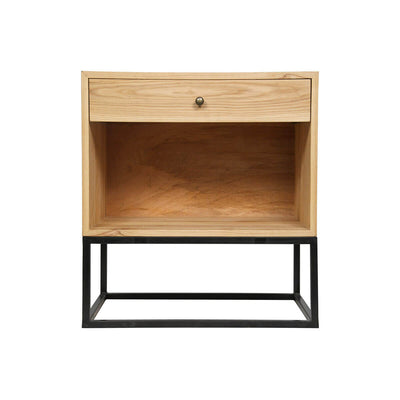 The Rosario Side Table is made of elm wood with a single drawer and open lower shelf on a black metal base in a geometric shape.