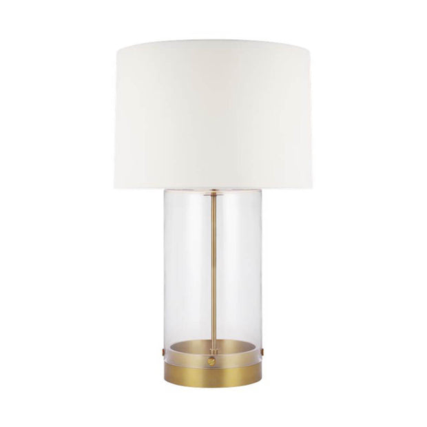 The Bilbao Table Lamp with a clear glass cylindrical base and brass detailing.