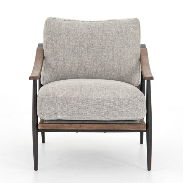 Light grey chair with cushion and wooden frame.