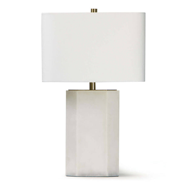 The Ingalls Table Lamp with an alabaster column base, brass hardware and complimenting white linen shade.