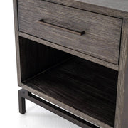 Closeup of the drawer and open shelving that provide lots of storage in the oak bedroom nightstand.