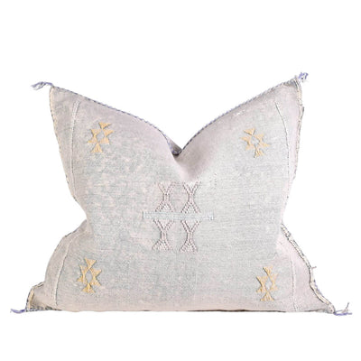 The Sabra Silk Pillow - Grey is a handmade silk pillow with natural dyes, feather fill and embroidered details.