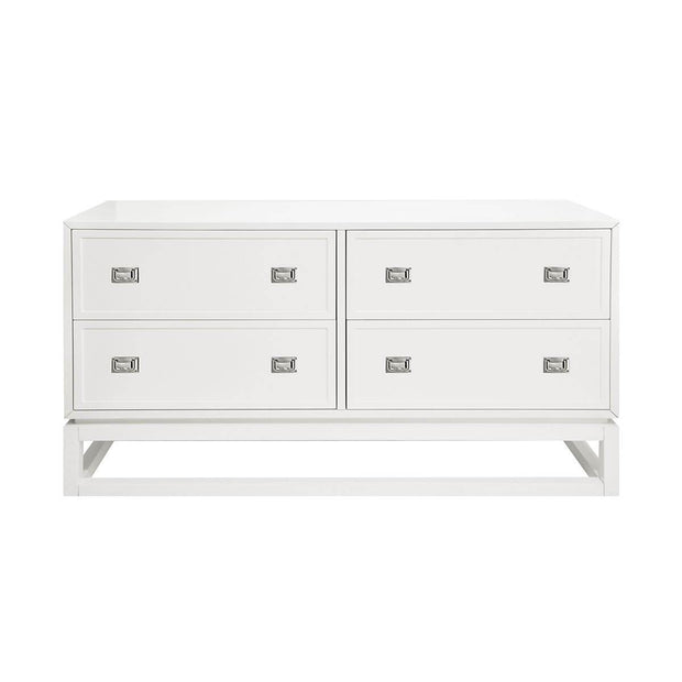 The Haikou Dresser is a matte white lacquer dresser with nickel hardware and a simple shape.