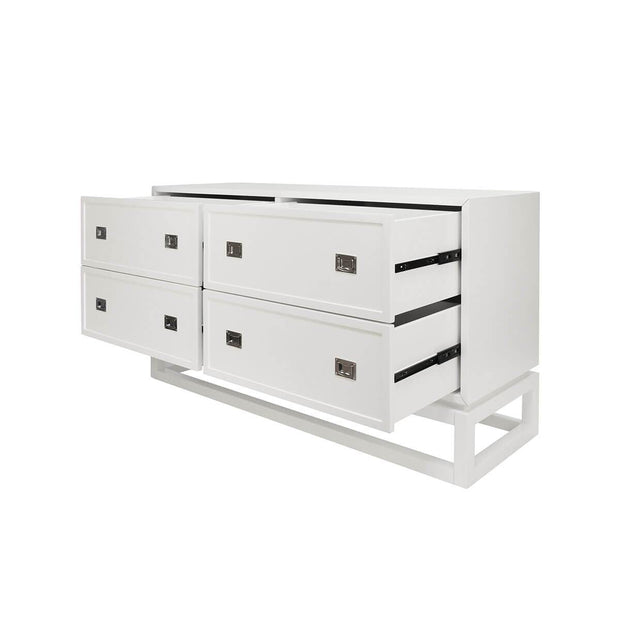White modern dresser with four drawers open.
