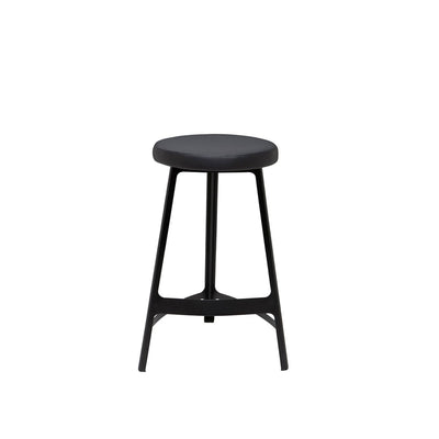 The Naha Counter Stool has a steel frame, slightly curved lines, and a faux leather seat.