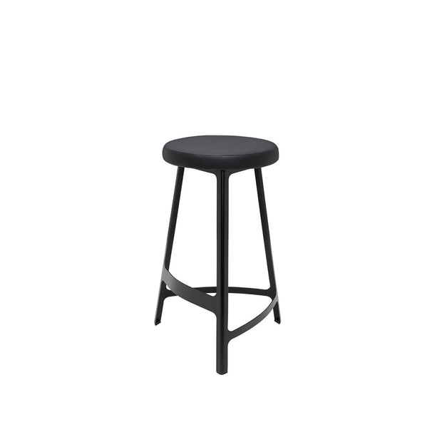 Black metal stool with slightly curved lines and a faux leather seat.