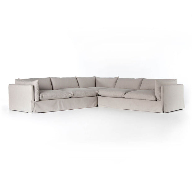The Strathcona Sectional is a slipcovered sectional with shelter arms and pillow-inspired cushions.