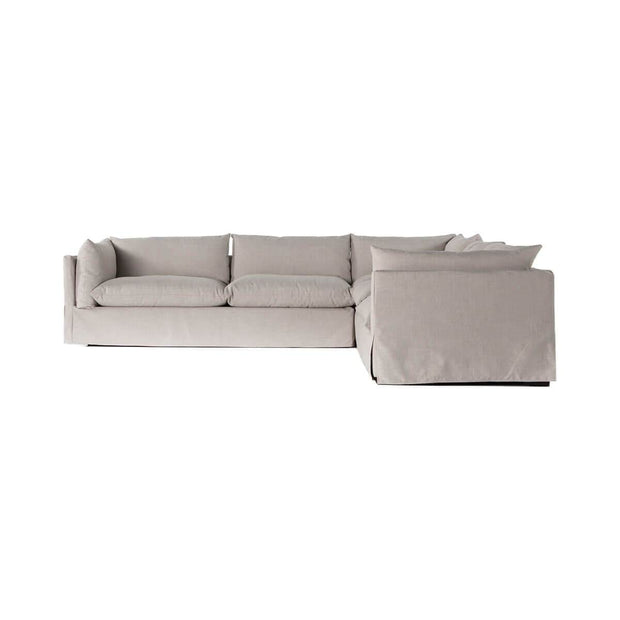 Neutral, slip covered sectional with high arms and comfortable cushions.